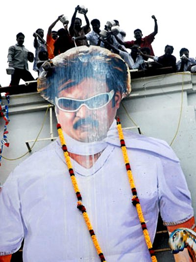 Rajnikanth's cardboard cutout being poured with Milk