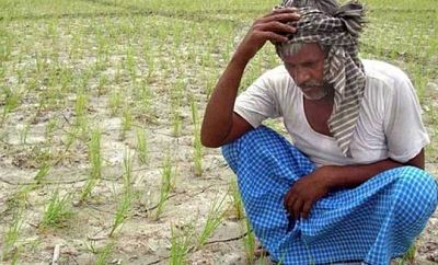 Dejected Indian farmer after crop loss