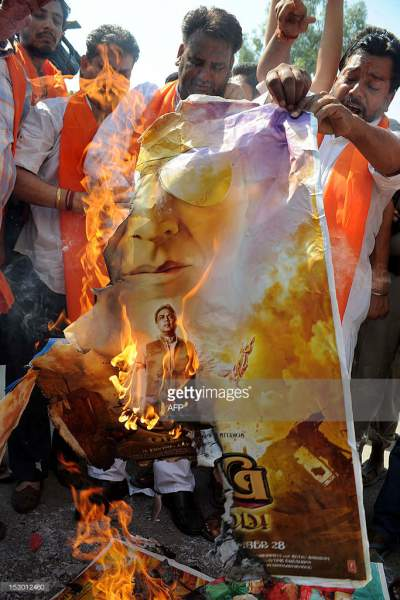 Oh My God movie poster being burned as protest by Shiv Sena