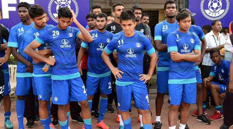 Indian football players dejected after a loss