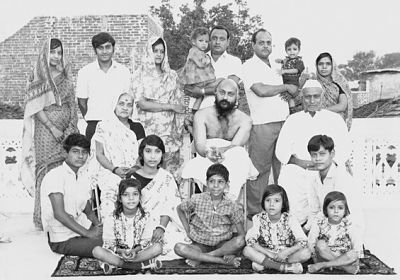 Osho Rajneesh in an old picture with his family