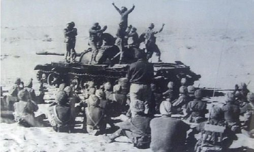 Indian soldiers celebrating on a destroyed Pakistani tank - Mythical India