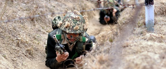 BSF Commandos crawl under barbed wire - Mythical India