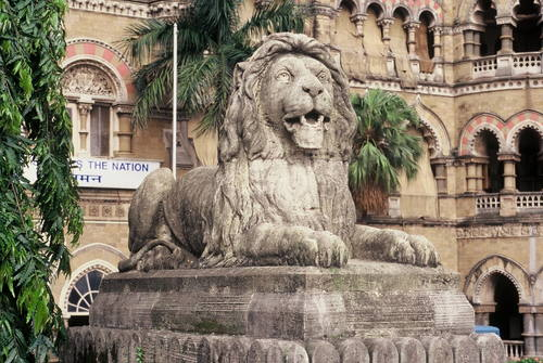 The lion sculpture at the entrance of CST - Mythical India