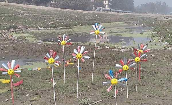 The flowers made of Tin placed at Yamuna riverbed - Mythical India