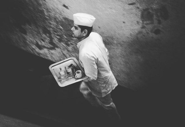 Picture by Anindito Mukherjee captured a waiter at College street coffee house - Mythical India