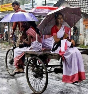 Photo by Kushal Gangopadhay capturing girls going to school even during rainy season - Mythical India