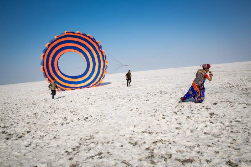 Uttarayan Kite Festival in the white desert of Kutch, Photograph by Tom Robinson - Mythical India