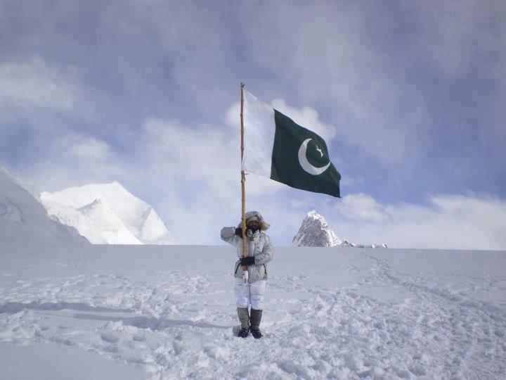 A Pakistani soldier standing in siachen with Pakistan's flag - Mythical India